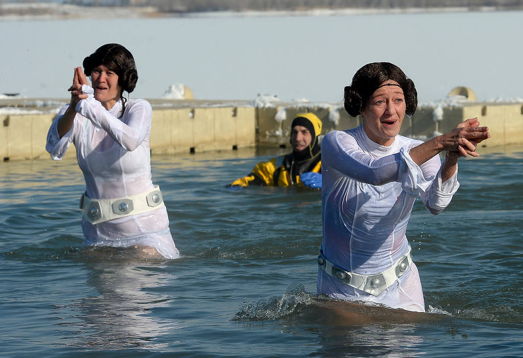 ". BOULDER, CO - January 1, 2019:  Michelle Kinkead, left, and Shawna Kinkead, of the ""Don\'t Call me a Princess!\""   team, use their blasters to escape the waterduring  the annual Polar Plunge at the Boulder Reservoir on January 1, 2019. For a video and photos, go to dailycamera.com.  (Photo by Cliff Grassmick/Staff Photographer)"