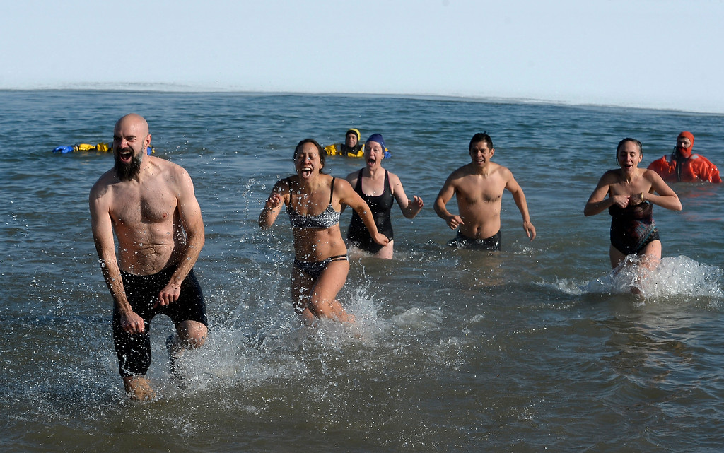 . BOULDER, CO - January 1, 2019: Another team completes the goal during  the annual Polar Plunge at the Boulder Reservoir on January 1, 2019. For a video and photos, go to dailycamera.com.  (Photo by Cliff Grassmick/Staff Photographer)