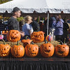 Pumpkins wait for judging while spectators stroll through the many booths at Saturday's Pumpkinfest.