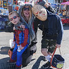"""Cat woman Libby Darling is flanked by """"Spidey"""" Luke and """"Jason"""" Jax Desormiers."""