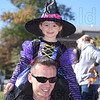 Junior witch Amedia Martins gets good view from superdad Jake's shoulders.