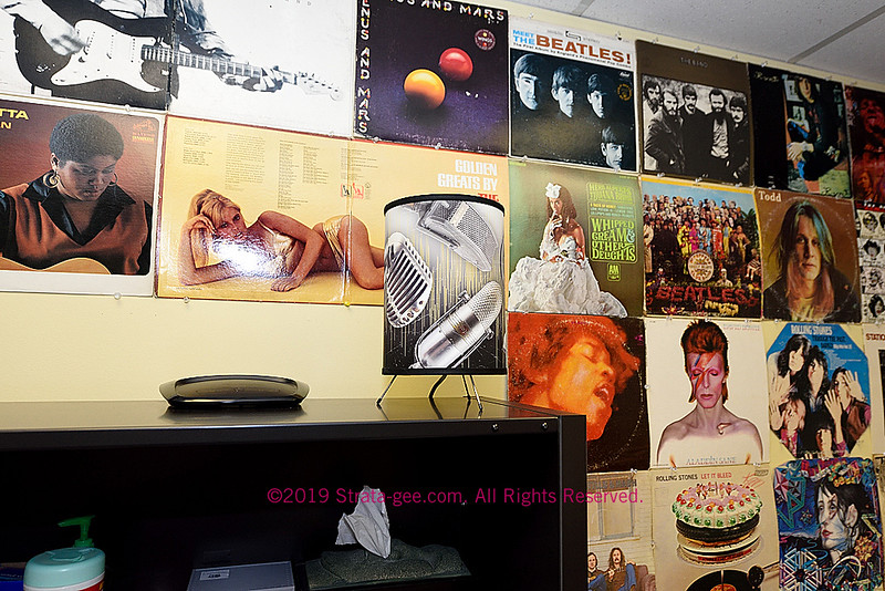 Album covers decorating an office at Russound