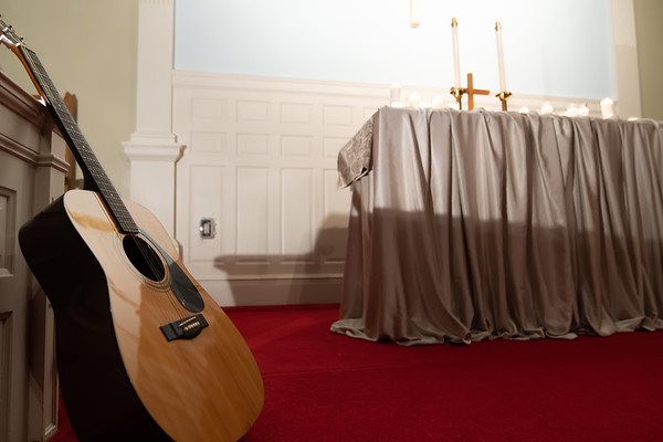 guitar standing at church altar before service