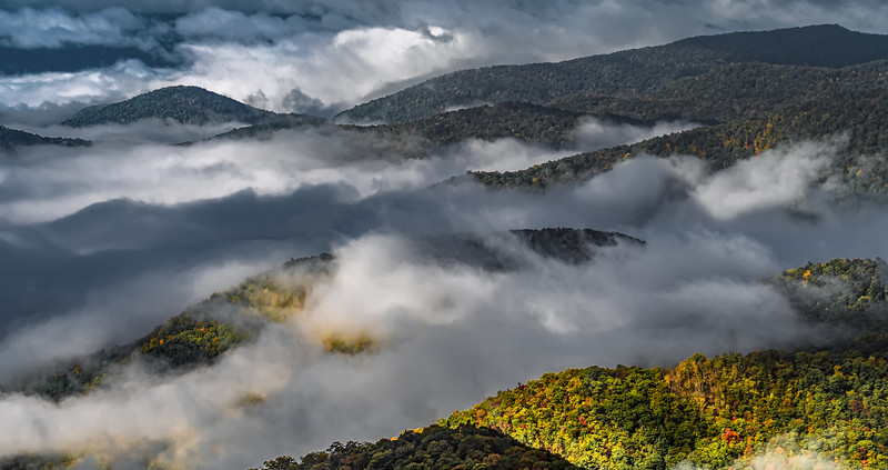 early morning autumn foggy photo at blue ridge parkway north carolina