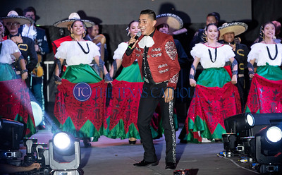 Hugo Salcedo, center performs during a concert on the grounds of San Juan Diego Catholic Church in Dallas on Sept. 1 for the parish's annual festival. (David Woo Photo)