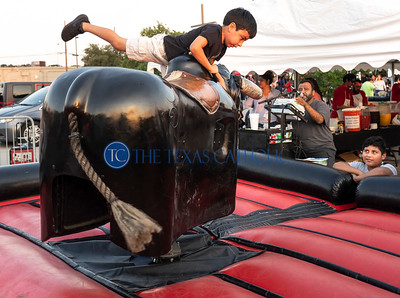 Baltazar Ruiz, 5, of Carrolton, rides a mechanical bull during the annual festival at San Juan Diego Catholic Church in Dallas on Sept. 1, 2029. (David Woo Photo)