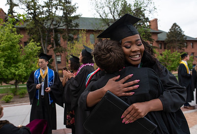 Palesa Mokoena hugs a fellow graduate before the 2019 commencement ceremony at Colorado College in Colorado Springs on Sunday, May 19, 2019.