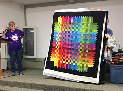 Jan also showed us a quilt that she made for the upcoming raffle to be sponsored by CCQG.  Machine quilted by John Putnam.