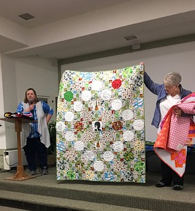 Cindy showing us a quilt made for a friend that has cancer.  The quilt has Bob Dillon in the center as her friend is a Dillon Fan.  He is also a Simpsons fan and she found some fabric featuring the Simpsons.