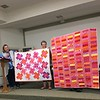 Cindy Mielock showing two quilts.  Both for the Teal Project.