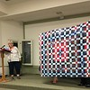 Carolyn Solomon showed a quilt made by the Scrap Fever group.  It is a Quilt of Valor.  Blocks by Scrap Fever members, assembled by Pam Marcus, and quilted by John Putnam.
