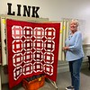 "The winner of the CCQG Board ""house block quilt top"""