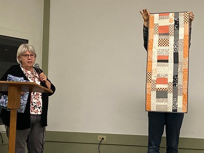 Carolyn Solomon showed us a quilt-as-you go table topper made from a charm pack.  Pattern is Fast and Furious.