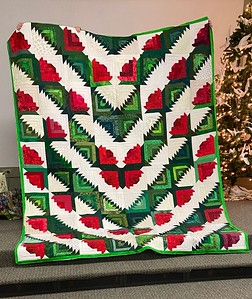 This Log Cabin quilt was also pieced by Dorothy Jones and is being finished by Kelly Sattler.