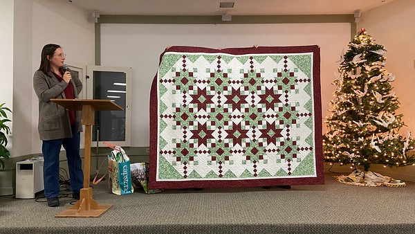Kelly Sattler with a quilt that was pieced by Dorothy Jones, a longtime and former member of CCQG,.  Kelly is finishing the quilt for the family.