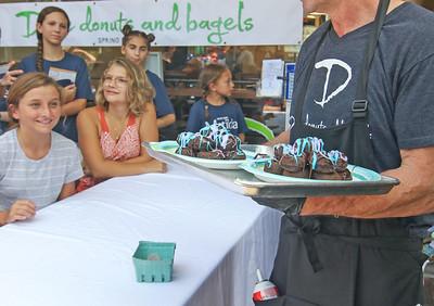 The Spring Lake sidewalk sale and doughnut eating contest in Spring Lake, NJ on 8/17/19. [DANIELLA HEMINGHAUS]