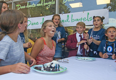 [2nd in from left] Michelle Beer, from Spring Lake, wins the older kid portion of the contest The Spring Lake sidewalk sale and doughnut eating contest in Spring Lake, NJ on 8/17/19. [DANIELLA HEMINGHAUS]
