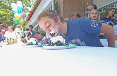 Gwynth Fahy, from Spring Lake. The Spring Lake sidewalk sale and doughnut eating contest in Spring Lake, NJ on 8/17/19. [DANIELLA HEMINGHAUS]