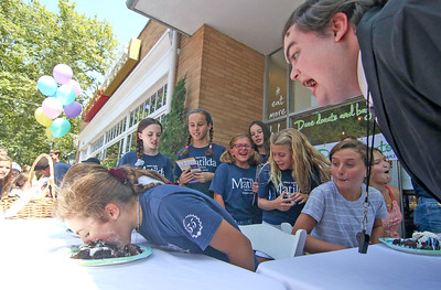 Tyler Cicardo, as Mrs. Trunchbull [on right] yelling at Gwynth Fahy, from Spring Lake. The Spring Lake sidewalk sale and doughnut eating contest in Spring Lake, NJ on 8/17/19. [DANIELLA HEMINGHAUS]