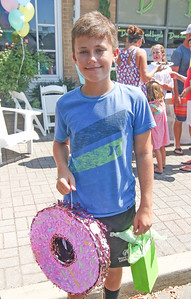 Finn Ivory, from Baltimore MD, wins the older kid competition. The Spring Lake sidewalk sale and doughnut eating contest in Spring Lake, NJ on 8/17/19. [DANIELLA HEMINGHAUS]