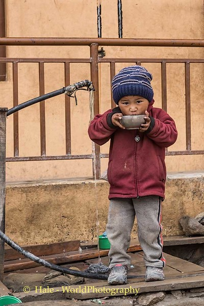 Young Student Having A Cool Drink of Water In the Morning