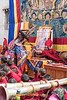 Lama Receiving Offering During Ritual