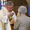 Fr. Jim distributes communion