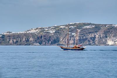 Santorini, Greece:  Tourist Boat & Village on the Hill