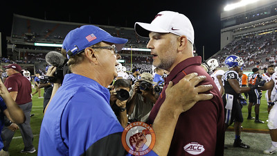 Duke head coach David Cutcliffe speaks with Virginia Tech head coach Justin Fuente following the final whistle. (Mark Umansky/TheKeyPlay.com)