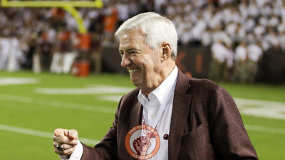 Former Virginia Tech head coach Frank Beamer smiles on the sidelines as he talks with Virginia Tech players from the 1999 football season. (Mark Umansky/TheKeyPlay.com)
