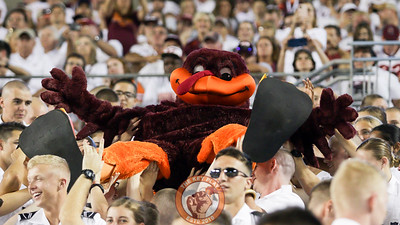 The Hokiebird is passed up the Corps of Cadets section in the South Endzone. (Mark Umansky/TheKeyPlay.com)