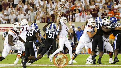 Virginia Tech QB Ryan Willis is hit in the arm as he throws by Duke's Victor Dimukeje. (Mark Umansky/TheKeyPlay.com)