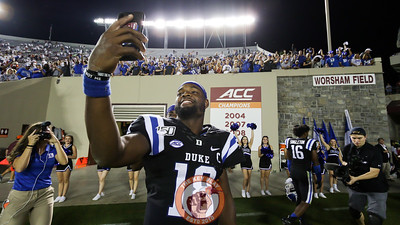 Winning Duke QB Quentin Harris takes a selfie with Duke fans who've walked down to the bottom of the East stands following the 45-10 Duke win. (Mark Umansky/TheKeyPlay.com)