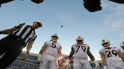 The team captains witness the coin toss right before kickoff. (Mark Umansky/TheKeyPlay.com)