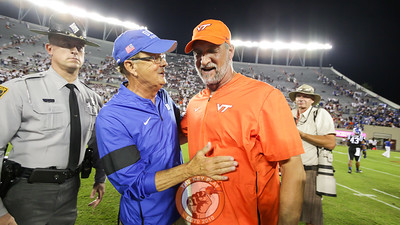 Duke head coach David Cutcliffe speaks with Virginia Tech defensive coordinator Bud Foster after the end of the game. (Mark Umansky/TheKeyPlay.com)