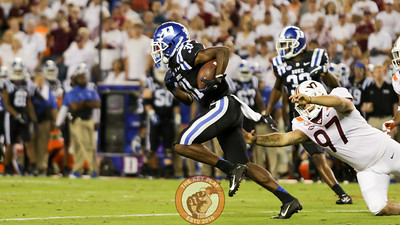 Duke's Josh Blackwell runs back with a punt as Virginia Tech's Oscar Shadley misses a tackle. (Mark Umansky/TheKeyPlay.com)