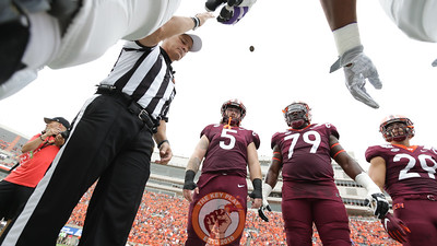 Referee Gary Patterson throws the coin toss before kickoff as Virginia Tech captains Jarrod Hewitt (5), Tyrell Smith (79) and Dalton Keene (29) watch. (Mark Umansky/TheKeyPlay.com)