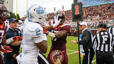 Virginia Tech defensive back Divine Deablo gets into a scuffle with UNC's Dyami Brown in the second quarter after a UNC touchdown. (Mark Umansky/TheKeyPlay.com)