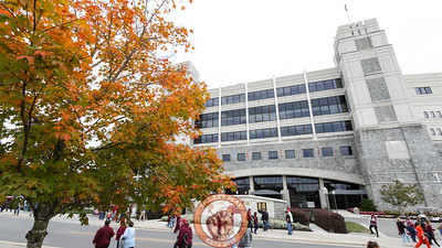 Fall colors are present outside Lane Stadium as fans walk past before gates open. (Mark Umansky/TheKeyPlay.com)