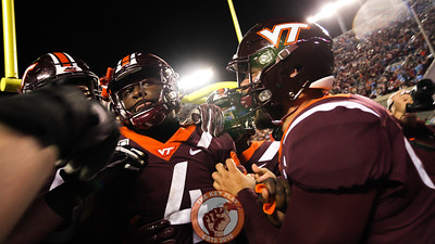 The Hokies swarm Quincy Patterson after scoring the game winning 2-point try in 6OT. (Mark Umansky/TheKeyPlay.com)