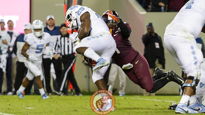 DB Reggie Floyd makes a tackle on UNC's Javonte Williams in 3OT. (Mark Umansky/TheKeyPlay.com)