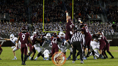 The Hokies block a UNC field goal in 4OT. (Mark Umansky/TheKeyPlay.com)