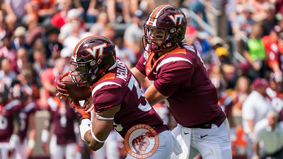 Ryan Willis (right) evaluates the defense before handing off to Deshawn McClease (33) in the matchup against Old Dominion University in Lane Stadium on Saturday, Sept. 7, 2019. (Photo: Cory Hancock)