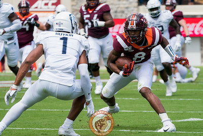 Phil Patterson jukes a tackler during the matchup against Old Dominion University in Lane Stadium on Saturday, Sept. 7, 2019. (Photo: Cory Hancock)