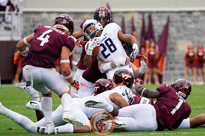 Hokie defenders convene on ODU's Blake Watson during the matchup against Old Dominion University in Lane Stadium on Saturday, Sept. 7, 2019. (Photo: Cory Hancock)