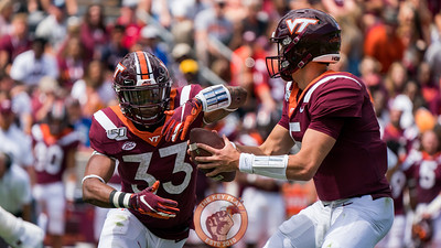 Ryan Willis (right) hands off to Deshawn McClease (33) in the matchup against Old Dominion University in Lane Stadium on Saturday, Sept. 7, 2019. (Photo: Cory Hancock)