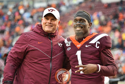 Justin Fuente and Reggie Floyd pose during Senior Day ceremonies prior to playing Pitt in Lane Stadium on Saturday, Nov. 23, 2019. (Photo: Cory Hancock/TheKeyPlay.com)