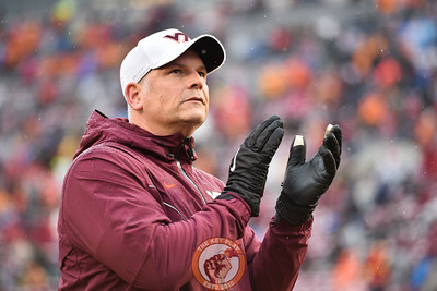 Justin Fuente claps prior to the seniors being recognized at the game against Pitt in Lane Stadium on Saturday, Nov. 23, 2019. (Photo: Cory Hancock/TheKeyPlay.com)