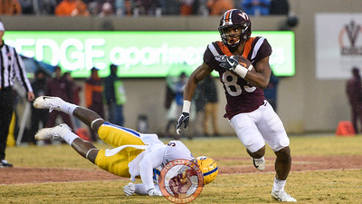 Tayvion Robinson escapes a diving John Morgan in the matchup against Pitt in Lane Stadium on Saturday, Nov. 23, 2019. (Photo: Cory Hancock/TheKeyPlay.com)