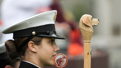 The Corps of Cadets carry a staff into Lane Stadium with a carving of Growley II on the head. (Mark Umansky/TheKeyPlay.com)